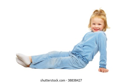 Happy little beautiful girl sitting on the floor in sport clothes isolated on the white background.
