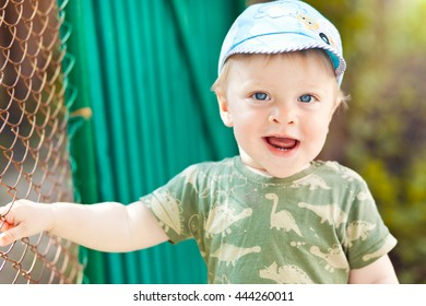 Happy little boy with blue eyes outdoor