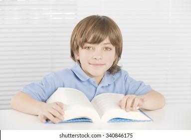 Happy little boy with book