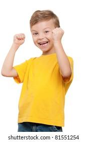 Happy little boy celebrating success over white background