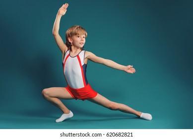 Happy little boy doing gymnastics