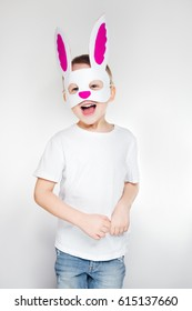 Happy little boy dressed up in animal mask for Easter