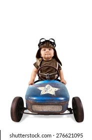 Happy little boy driving big vintage old toy car and having fun, isolated on white