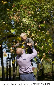 Happy Little boy and father in autumn park