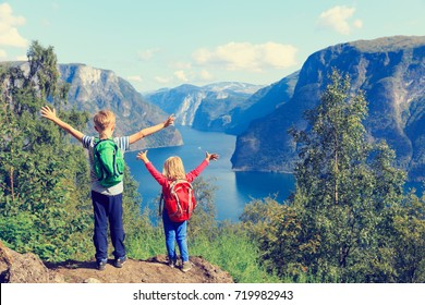 happy little boy and girl travel in Norway