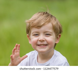 Happy little boy having fun at the park and smiling