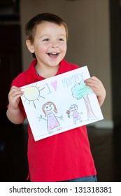 """Happy little boy holding a drawing for his Mom, """"I Love Mommy!"""""""