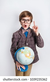 Happy little boy holding globe. Education. Back to school and happy time