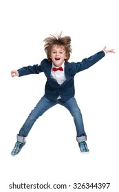 A happy little boy jumps on the white background
