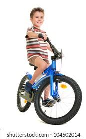 Happy little boy on bike  isolated on white