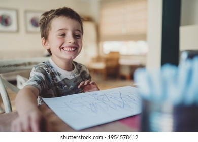 Happy Little boy on distant learning. Primary school from home. Happy boy learning from home.