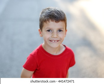Happy little boy, outdoor portrait