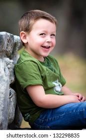 Happy little boy outdoors