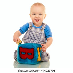 Happy little boy in overall with toys isolated on white