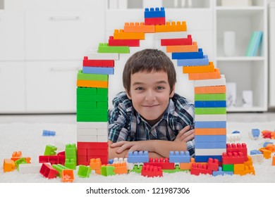 Happy little boy playing with blocks