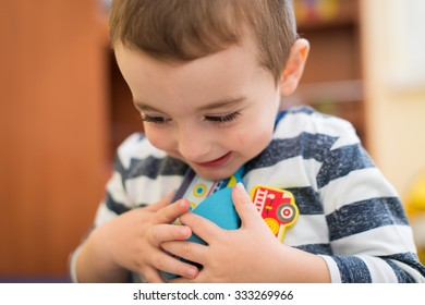 Happy little boy playing - close up photo