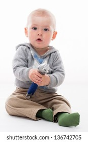 Happy little boy playing with the tool