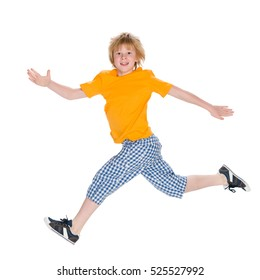 A happy little boy runs on the white background