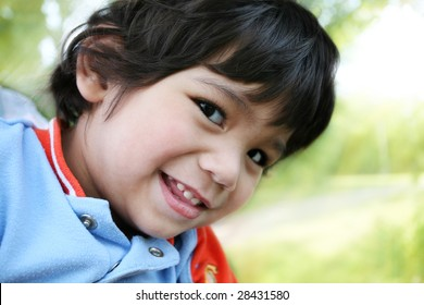 Happy little boy smiling