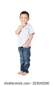 Happy little boy standing , isolated on white background