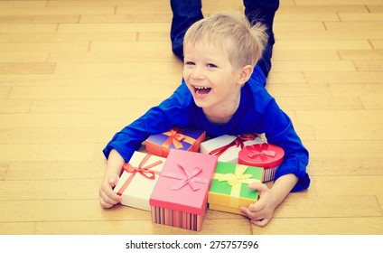 Happy little boy taking presents at family holiday