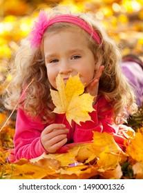 Happy little child in autumn park