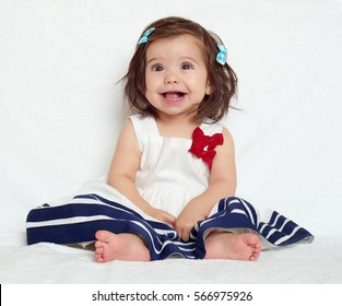 happy little child girl sit on white towel, happy emotion and face expression