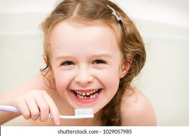 Happy little child  lost  primary tooth