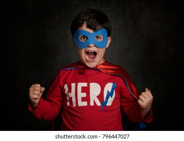 Happy little child playing superhero