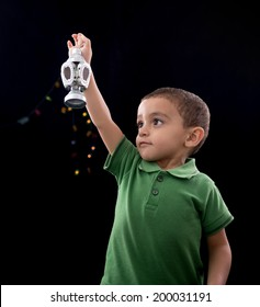 Happy Little Child with Ramadan Lantern on Defocused Night Lights Background
