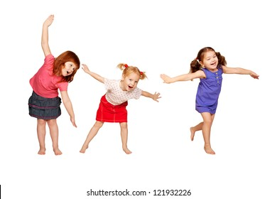 Happy little children dancing in air. Red-haired, blonde and brunette girls. Joyful party.  Isolated on white background.