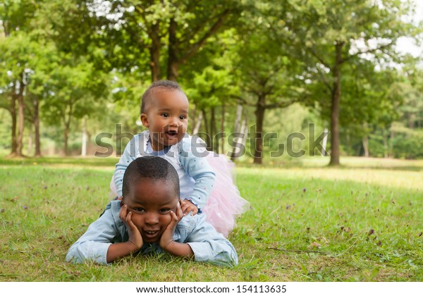 Happy little children are having a nice day in the park