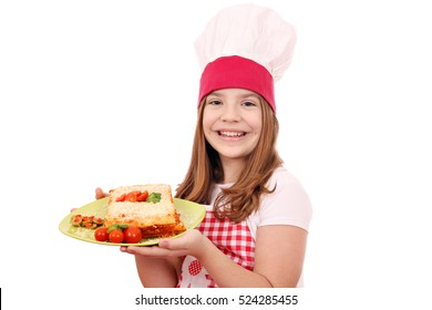 happy little cook girl with lasagne on plate