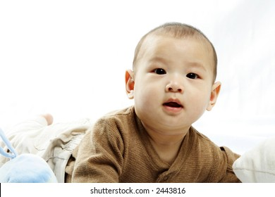 A happy little cute baby (isolated white)