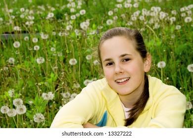 Happy little girl  (11 years)  enjoy on  meadow grass.
