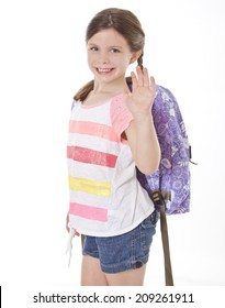 Happy little girl with backpack isolated on white waving goodbye