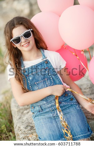 d91d13016f2d Happy little girl with balloons summer portrait. Hipster look child girl 10  year old with sunglasses and balloons wear jeans dress and posing outdoors  at ...