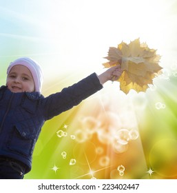 Happy Little Girl with bouquet autumn yellow dry leaves.Golden Autumn concept