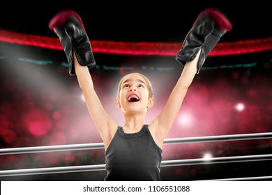 happy little girl boxer win a fight in a ring