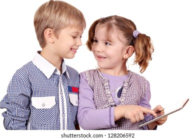 happy little girl and boy play with tablet pc