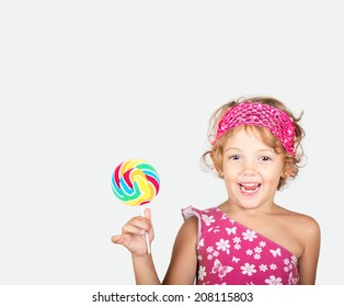 happy little girl with candy in hand