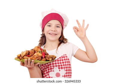 happy little girl with chicken drumstick and ok hand sign