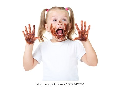Happy little girl in chocolate on white background