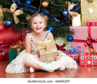 Happy little girl with Christmas gifts