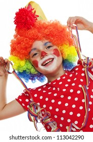 happy little girl with clown costume