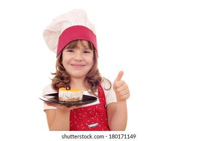 happy little girl cook with cake and thumb up