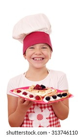 happy little girl cook with crepes
