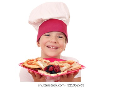 happy little girl cook with crepes portrait