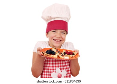 happy little girl cook with delicious crepes