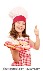happy little girl cook with donuts and thumb up